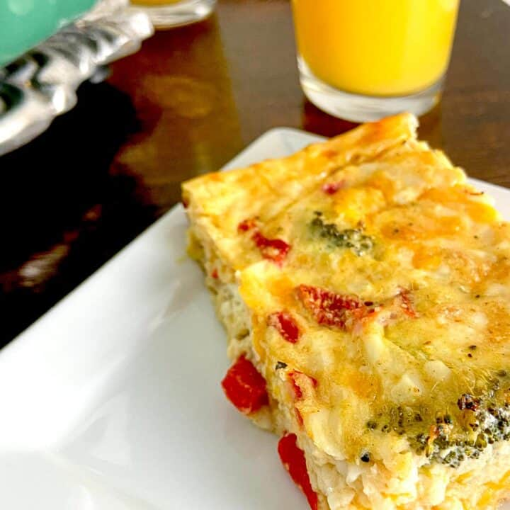 Slice of low carb egg casserole on plate.