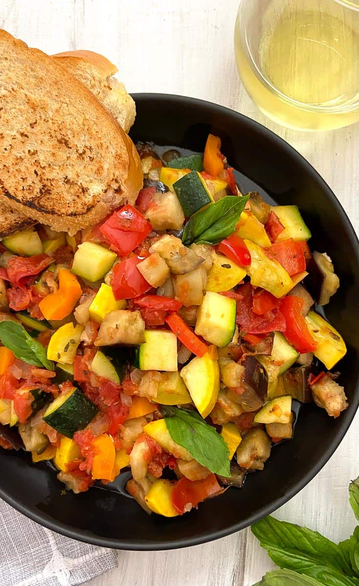 Classic French Ratatouille in black bowl.