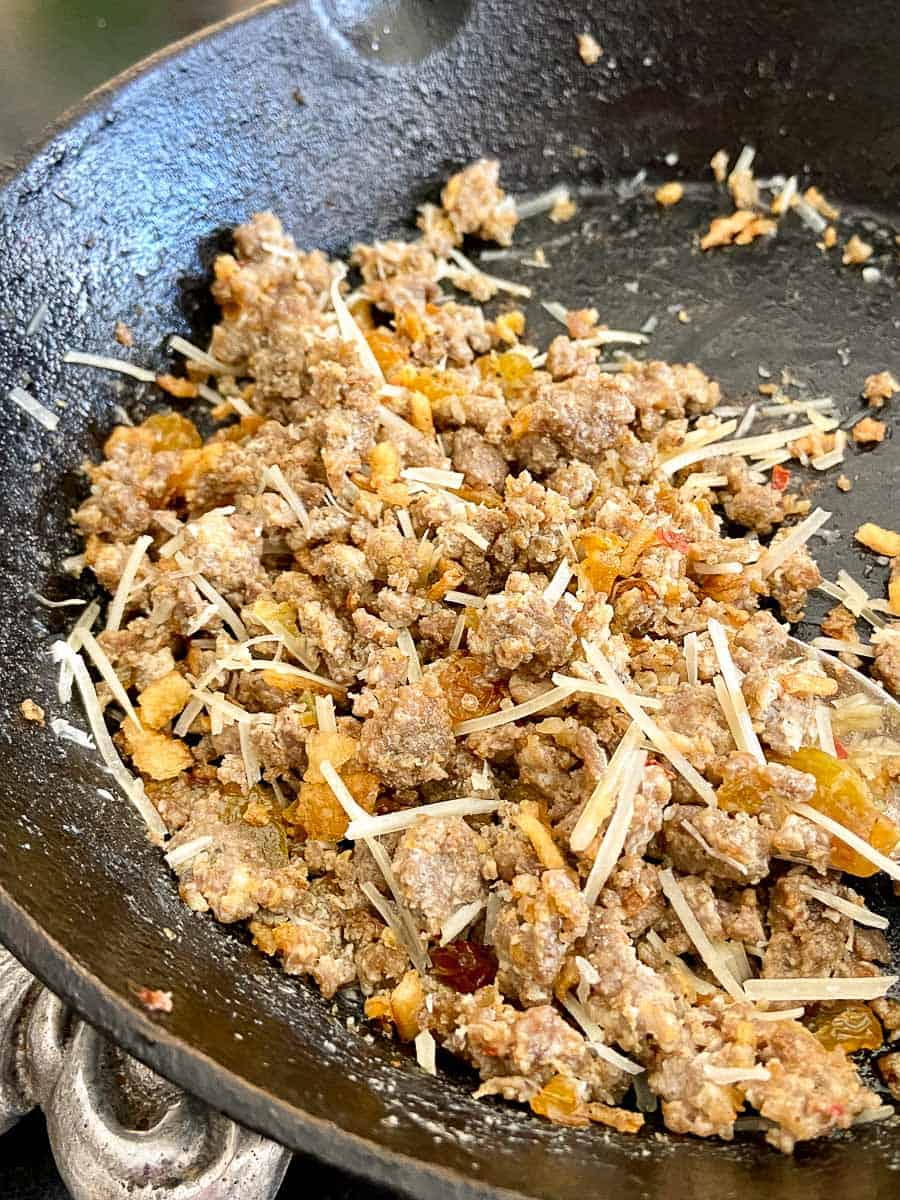 Sausage and cheese mixture in skillet.