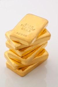 Gold bars represent real money vs. imaginary digital currency
