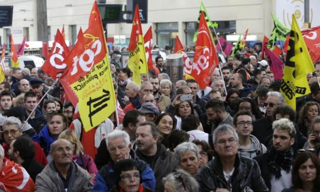 Rail workers march en masse to protest Macron's proposed cuts | The National