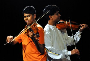 Brothers Bond Through Violin