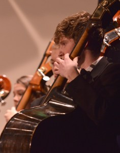 Sophomore Bryce Flora plays the cello during the performance. Photo by Kylie Rellihan