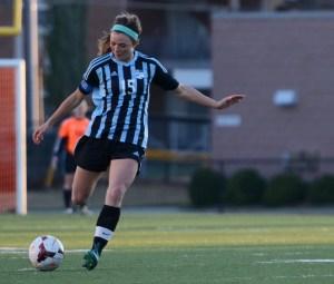 Junior Emma Braasch goes in for a kick. By Katie Lamar
