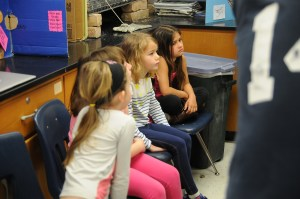 Students visiting from Corinth learn about birds