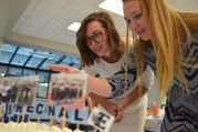 Sophomore Fallon Herrick checks out the pictures used to decorate the Lancer cake. Photo by Annie Lomshek.