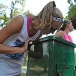 Junior Carolyn Kinney stops for water at Porter Park.  Photo by Tess Iler