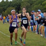Senior Spencer Carey sprints to the finish line attempting to win the race.  Carey placed 2nd overall.  Photo by Tess Iler