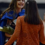 Shawnee Mission East alumni, and last years Sweetheart Queen Bea Workman crown this years queen, Ellie Cook at halftime. Photo by Izzy Zanone