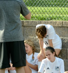 Freshman Brooklyn Manning is disappointed in her team's performance in the first half while coach Elliot Pattison talks to them during halftime. Photo by Luke Hoffman