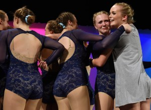 Sophomore Hannah Goettsch runs to senior Isa Tamburini after her last performance in the senior group dance to hug her goodbye. Photo by Lucy Morantz