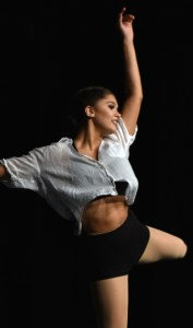 Senior Hayley Bell finishes a turn sequence in her senior solo performance. Photo by Lucy Morantz