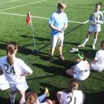 Coach Paddington gave a pep talk at half time. Photo by Carson Holtgraves