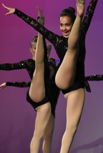 Sophomore Gia Hense does high kick during JV dance routine. Photo by Carson Holtgraves