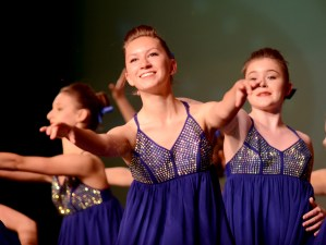 Freshman, and JV drill team member, Eva Hill performs in their team lyrical dance. Photo by Maddie Smiley