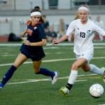 Sophomore Lauren Sandow goes for the ball. Photo by Luke Hoffman
