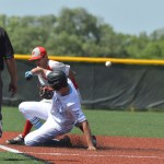 Senior Cameron Fritz slides into second safely after hitting a double.