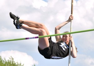 Freshman Brooklyn Beck pole vaults over the bar. Photo by Laini Reynolds