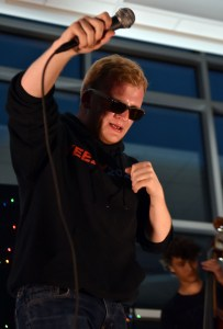 Senior Deegan Pores pretends to drop the microphone at the end of one of his performances. Photo by Lucy Morantz