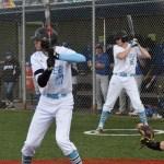 Senior Cameron Fitz watches the pitcher for practice while senior Zebulon Vermillion bats. Photo by Izzy Zanone