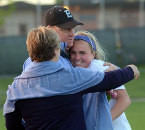 Senior Hailey Mohr hugs her parents after her name gets called for senior night. Photo by Katherine Odell