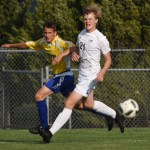 Sophomore Alex Anderson watches the ball his opponent has just kicked toward the goal. Photo by Ellen Swanson