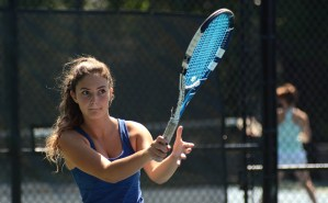 Sophomore Carolyn Popper keeps her eye on the ball during her match. Photo by Ty Browning