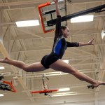 Performing a no fall beam routine, sophomore Brooklyn Beck does a split leap. Photo by Aislinn Menke