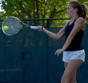 Senior Toni Englund returns the ball in her singles match. Photo by Luke Hoffman