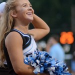 Senior Mya Hutcherson smiles as she looks up at the crowd of blue in the stands. Photo by Kate Nixon