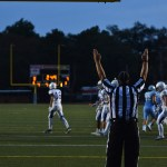 After junior Parker Willis scores an extra point, the referee calls the kick good making the score 7-0. Photo by Lucy Morantz