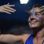 Senior Katie Hise signals to the student section to begin a chant. Photo by Lucy Morantz