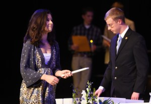 Junior Elle Angelo walks towards Dr. McKinney in order to receive her NHS diploma. Photo by Katherine Odell