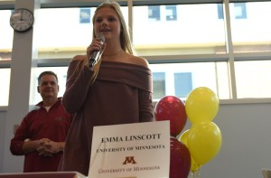 Senior Emma Linscott gives a speech as the microphone is passed around to all the commits. Photo by Morgan Plunkett