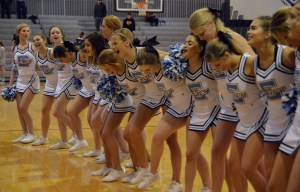 The cheerleaders sing the school song with the student section at the end of the game. Photo by Ally Griffith