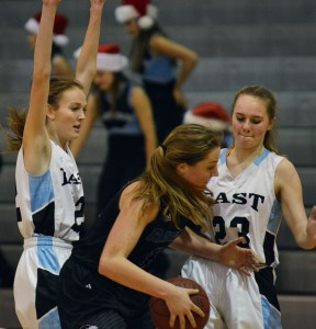Sophomores Elizabeth Long and Camryn Gossik guard an ONW player. Photo by Ally Griffith