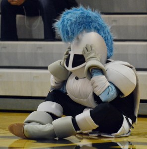 The Lancer mascot puts his hands to his head after a  missed free throw. Photo by Ally Griffith