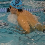 Junior Sam Bruck swims breaststroke in practice. Photo by Kathleen Deedy