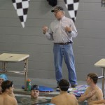 Coach Wiley Wright explains a set to the boys. Photo by Kathleen Deedy