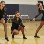 Freshmen Taylor Keal, Ashley Osborn, and Jess Pindell pose at the end of their routine. Photo by Ellen Swanson