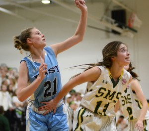 Senior Sofia Stechshulte is held back by an opponent while trying to get a rebound. Photo by Aislinn Menke