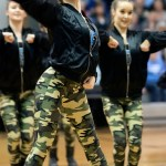 Freshman Claire Baker performs during the JV Lancer Dancer halftime performance of their hip-hop routine. Photo by Lucy Morantz