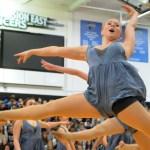 Junior Hannah Goettsch leaps during the Lancer Dancer performance. Photo by Izzy Zanone