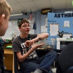 Talking to the Pawnee students, Junior Will Kitler shows them the pet tarantula. Photo by Grace Goldman