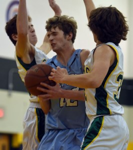 Sophomore Will Schneider holds on to the basketball as his opponents try and take possession of it. Photo by Katherine Odell