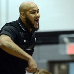 Coach Vincent shouts as senior Andrew Schmidt wrestles. Photo by Katherine McGinness
