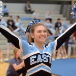 Junior Lucy Crum cheers in front of her classmates in the junior section. Photo by Katherine McGinness