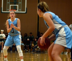 Sophomore Kathleen Stanley claps to get her teammate's attention for a pass. Photo by Kate Nixon