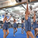While students walk from their seminar classes to gather in the main gym, juniors and Varsity Lancer Dancers Scout Rice, Megan Walstrom, and Sarah Grimm perform. Photo by Lucy Morantz