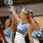 Senior Lauren Packer cheers at the outset of the boys varsity game. Photo by Luke Hoffman